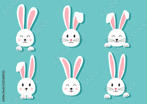 Photo Cute Easter bunnies hand drawn, paper face of rabbits on turquoise background