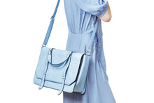 Woman Carrying A Blue Messenge...