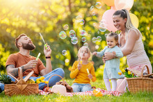 Happy Family Having Picnic In The Park