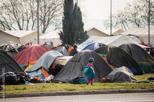 Spontaneous refugee camp by a gas station on the highway in the north of Greece, close to Idomeni Fototapeta