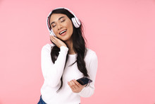 Cheerful Pretty Young Asian Woman Listening To Music