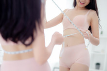 Beautiful Young Asian Woman Sexy Body Slim Measuring Abdomen For Control Weight Loss Looking Mirror In The Room, Beauty Girl Belly Thin Have Cellulite With Tape Measure For Diet, Health Concept.