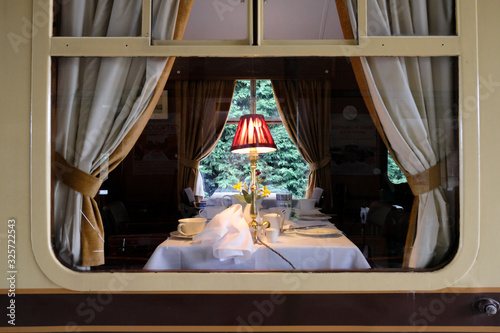 Fotografie, Obraz Interior view from a railway platform of a first class dining area located on a famous railway