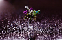 A Small Bouquet Of Flowers In ...