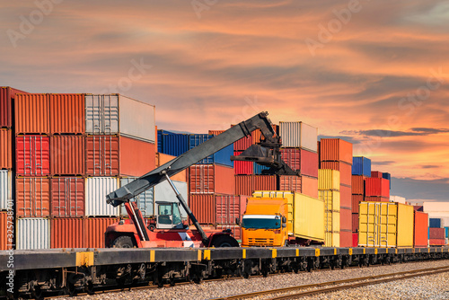 Canvas Print crane lifting container box to container truck a logistics transports in shipyar