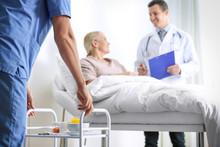Nurse Bringing Medicine On Ser...