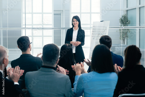 Fototapeta businesswoman making a presentation for the employees of the company obraz