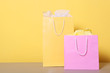 bags for shopping on a colored background. Paper bags for shopping.