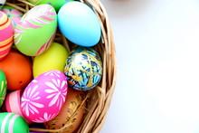 Easter Eggs In Basket On White...