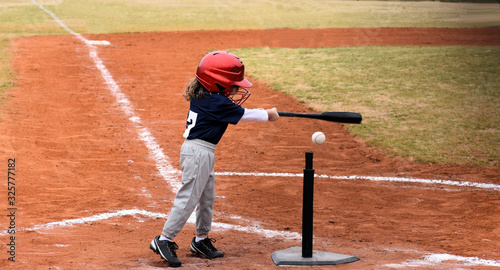 Fototapeta Baseball kid up at bat making a hit obraz