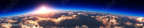 Fototapeta Sunrise over the planet. Panorama of clouds under the sun. obraz