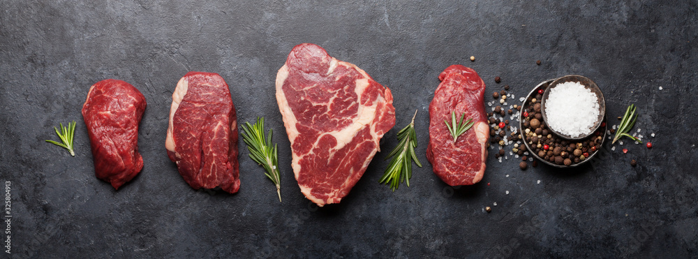 Fototapeta Variety of raw beef steaks