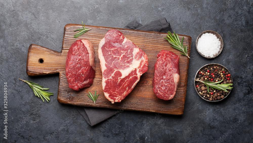 Fototapeta Variety of raw beef steaks