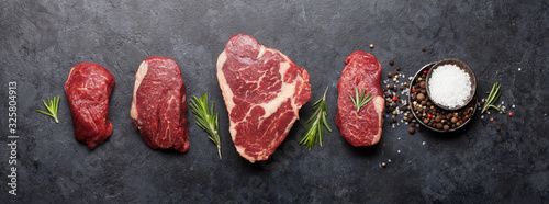 Variety of raw beef steaks - 325804913