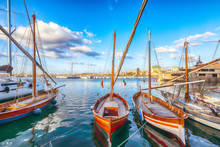 Summer View Of The Alghero Marina Yacht Port At The Gulf Of Alghero With Anchored Sailboats