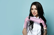 Portrait of young smiling sexy brunette woman doctor, nurse, cosmetologist, chemist in uniform taking on medical mask