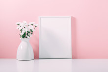 Front View Blank Mock Up Of Photo Frame On Pink Background.  Home Interior Floral Decor. Beautiful Flowers In  Vase On Pink Wall Background.