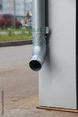 Fototapeta drainpipe on the corner of the house