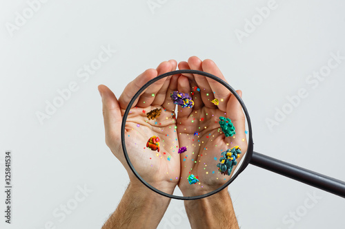 Obraz Close up on a sick man hand through magnifying glass transmitting virus by skin contact 3D rendering - fototapety do salonu