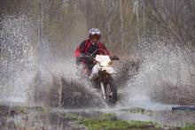 Motorcross Rider Racing In Flo...