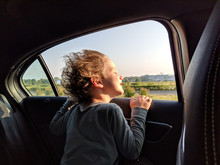 Boy Leaning On Window While Tr...