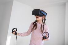Girl Using A Virtual Reality Oculus Headset