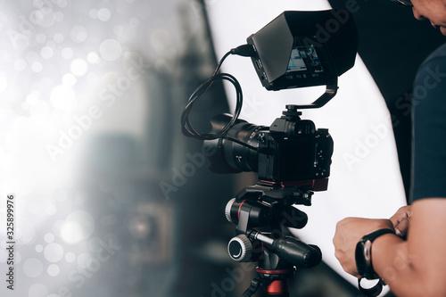 Fényképezés videographer, professional camera, man with camera