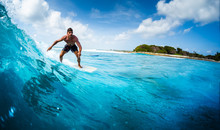 Young Athletic Surfer Rides Th...