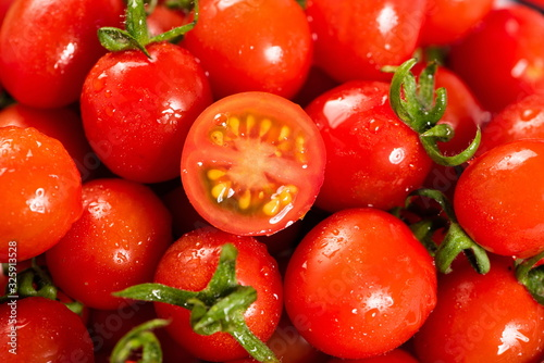 Fotografia, Obraz The red little tomato is under the wooden cutting board