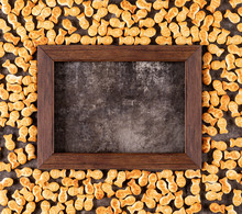 Top View Crackers Texture With Copy Space In Wooden Frame On Black Stone Background Horizontal