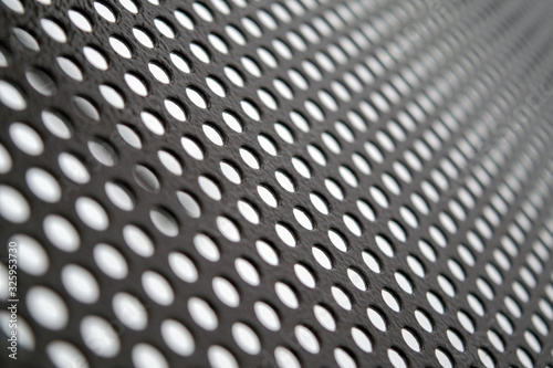 Texture of perforated metal sheet abstract background Canvas Print