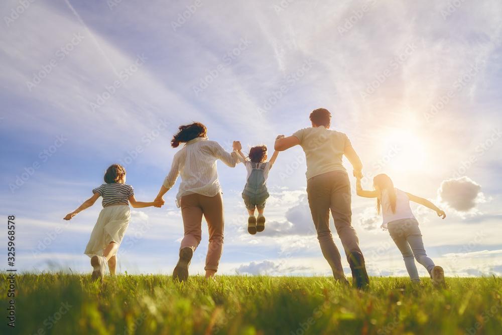Fototapeta Happy family on summer walk
