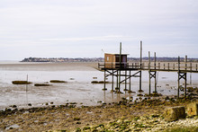 Fish Net Low Tide On Wooden Hut Cabin For Fisherman In Saint-Palais-sur-Mer France