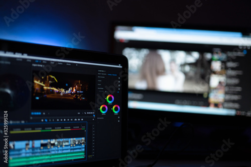 Fototapeta Editor display video editing color grading to upload content on social media or