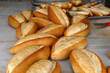 a large amount of freshly baked bread in the bakery,