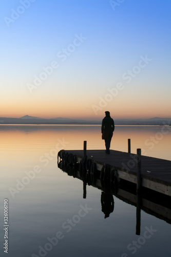 jetty of saler lake at sunset, in the lagoon #326006190