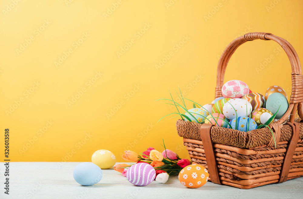 Fototapeta Happy easter, Easter painted eggs in the basket on wooden rustic table for your decoration in holiday. copy space.