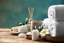 Beautiful Spa Composition With Plumeria Flower On Wooden Table. Space For Text