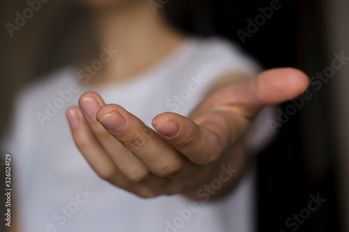 young woman's hand reaching out Canvas Print