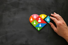Image Of Heart Shape Tangram Puzzle Blocks With People Icons Over Wooden Table ,human Resources And Management Concept