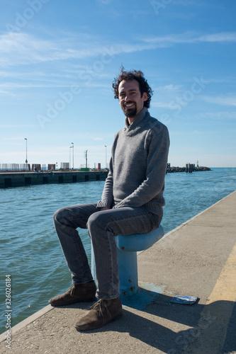 smiling man at the sea Canvas Print