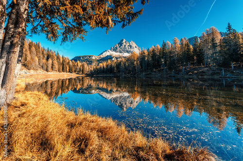 Wall mural -  Scenic image of fairy tale Mountain lake under sunlit. Wonderful Antorno lake in sunny day. Famous location in Dolomites Alps . Italy. Amazing Autumn nature Landscape. Popular Travel destinations