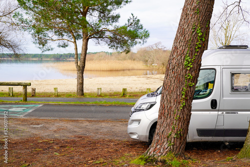 Tablou Canvas campervan by lake sea in summer concept of vanlife in french coast in Sanguinet