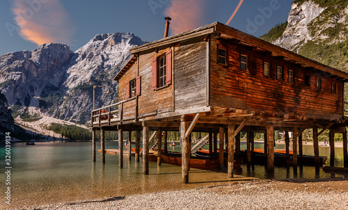 Wall mural - Impressive view of Lago di Braies at sunrise. Trentino Alto Adidge, Dolomites mountains, South Tyrol, Italy, Europe. Incredible Nature Landscape. Braies lake, Pragser wildsee at sunny day