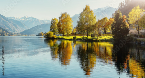 Wall mural - Impressively beautiful Fairy-tale mountain lake in Austrian Alps. Breathtaking Scene. Panoramic view of beautiful mountain landscape in Alps with Zeller Lake in Zell am See, Salzburger Land, Austria