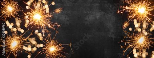 Fotomural Silvester background banner panorama long- firework on rustic dark black grey st