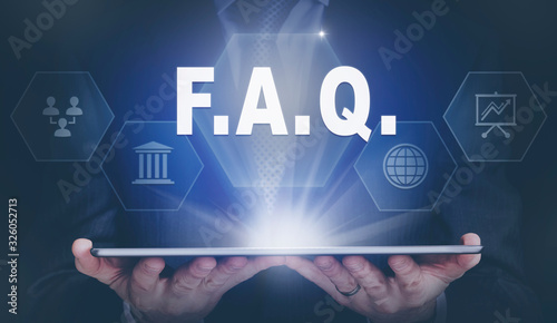 Businessman holding a computer tablet display projecting a FAQ concept Canvas Print