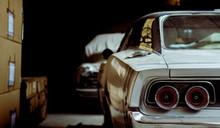 Retro Cars In An Old Dark Ware...