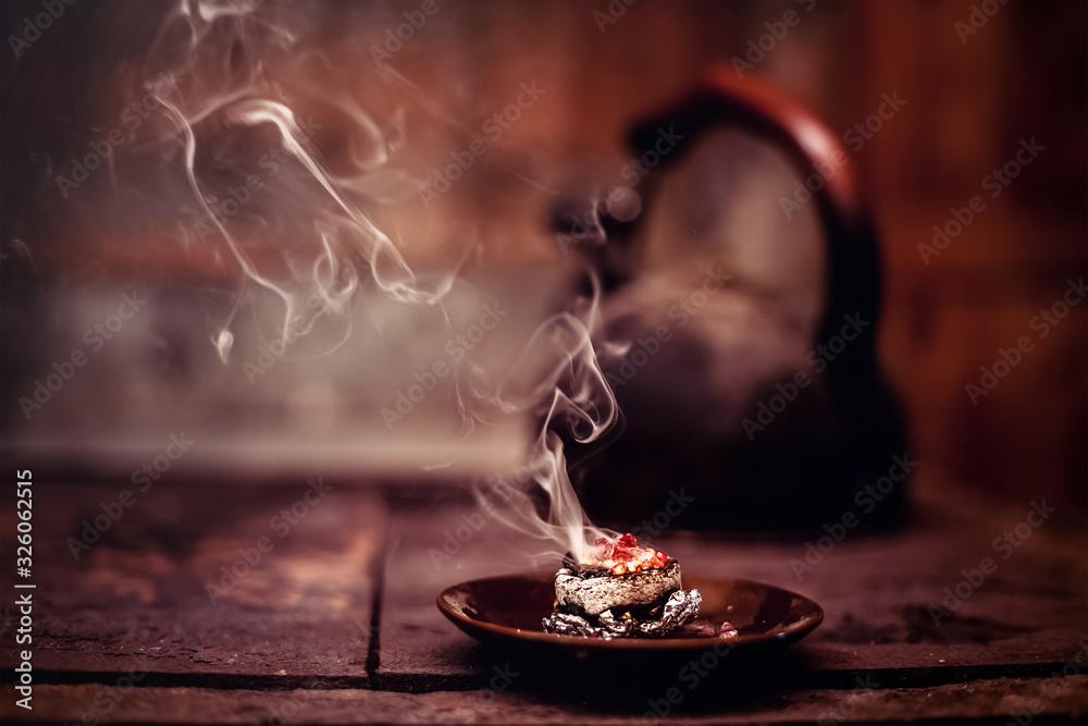 Fototapeta Frankincense burning on a hot coal. Aromatic frankincense.