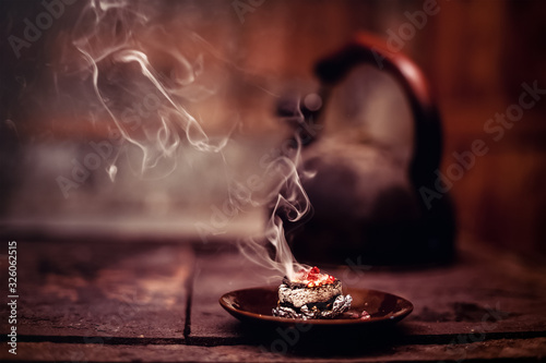 Fotografiet Frankincense burning on a hot coal. Aromatic frankincense.